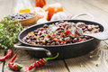 Meat stew with red beans and chili pepper on the table Stock Images