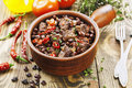 Meat stew with red beans and chili pepper on the table Stock Photos