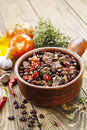 Meat stew with red beans and chili pepper on the table Stock Image