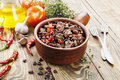 Meat stew with red beans and chili pepper on the table Stock Photo
