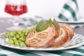 Meat stuffed cheese garnished green peas Royalty Free Stock Photos