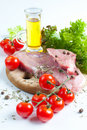 Meat, tomatoes and a salad Royalty Free Stock Image