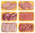 Meat on trays isolated white background Stock Photos