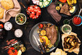 Meat and vegetables grill with wine and beer Royalty Free Stock Photo