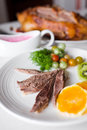 Meat with vegetables on plate Royalty Free Stock Image