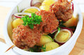 Meatball skewer and potatoes Stock Images