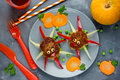 Meatball spiders. Creative food idea meatballs with colorful bel Royalty Free Stock Photo