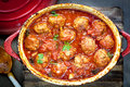Meatballs casserole in red iron crock pot Stock Image