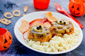 Meatballs with cheese in the form of mummies and couscous garnis Royalty Free Stock Photo