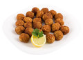 Meatballs on a plate on a white background and lemon Stock Photo