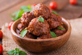 Meatballs in sweet and sour tomato sauce and basil Royalty Free Stock Photo