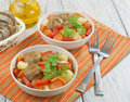 Meatballs vegetables bowl wooden table Royalty Free Stock Photography