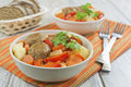 Meatballs vegetables bowl wooden table Royalty Free Stock Images