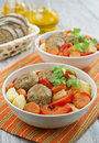Meatballs vegetables bowl wooden table Royalty Free Stock Image