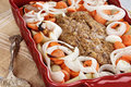 Meatloaf casserole dish of freshly prepared with onions carrots and potatoes shallow depth of field Royalty Free Stock Photography