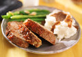 Meatloaf with greenbeans and mashed potatoes close up photo of dinner Royalty Free Stock Photo