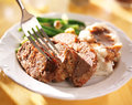 Meatloaf with greenbeans and mashed potatoes close up photo of eating it a fork Stock Image