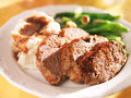 Meatloaf with greenbeans and mashed potatoes photo of a plate of Stock Photography