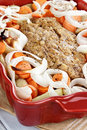 Meatloaf and veggies casserole dish of freshly prepared with onions carrots potatoes shallow depth of field Stock Images