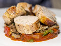 Meats guinea fowl ballotine fine dining roasted of on vegetable stew bed Stock Photo