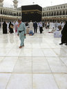 Mecca feb muslim pilgrims walk on after light drizzle at kaab kaabah area inside masjid al haram february in only Stock Photos