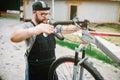 Mechanic adjusts the bicycle handlebars and brakes Royalty Free Stock Photo
