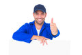Mechanic with blank placard gesturing thumbs up portrait of male on white background Royalty Free Stock Photo