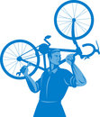 Mechanic carrying bicycle Stock Photo