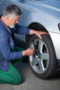 Mechanic changing a wheel Stock Photography