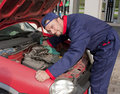 Mechanic Checking Engine Royalty Free Stock Photos