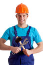 Mechanic with crossed tools hammer and wrench Royalty Free Stock Photos