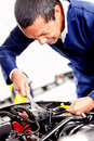 Mechanic fixing car engine Royalty Free Stock Photography