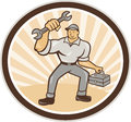 Mechanic holding spanner wrench toolbox cartoon illustration of a with carrying facing front set inside oval on isolated Royalty Free Stock Photography