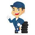 Mechanic leaning on tires