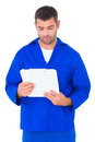 Mechanic reading clipboard Royalty Free Stock Photo