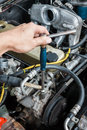 Mechanic repairing a car with a spanner unscrew the nut firmly Stock Photography
