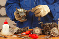 Mechanic repairing old car engine fuel pump the Stock Photos