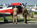Mechanic s working on small plane two mechanics the engine of a light aircraft Stock Images