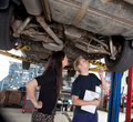 Mechanic Showing Customer Repairs Stock Photography