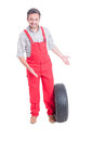 Mechanic showing new car tire Royalty Free Stock Photo