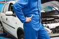Mechanic with spanner by car male leaning on Royalty Free Stock Images