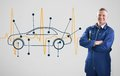 Mechanic standing in front of a background with car and heart line Royalty Free Stock Photos