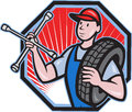 Mechanic With Tire Socket Wrench And Tire Stock Photos