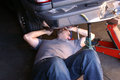 Mechanic working on car under a Royalty Free Stock Photography