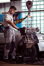 Mechanic working with engine Royalty Free Stock Photo