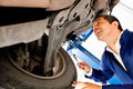 Mechanic working under a car Royalty Free Stock Photo