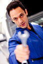 Mechanic with a wrench Royalty Free Stock Image