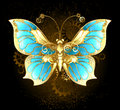 Mechanical butterfly brass and gold with wings decorated with blue glass and gears Stock Photography