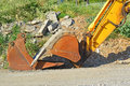 A mechanical diggers arm and bucket Royalty Free Stock Photo