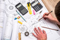 Mechanical engineer with work at technical drawings